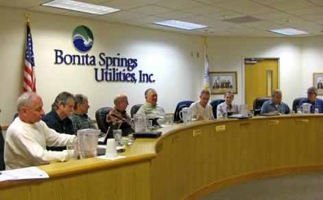 a picture of the board of directors at a meeting